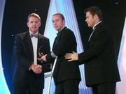 2 November 2007; James 'Cha' Fitzpatrick of Kilkenny is presented with his award by Dave Sheerin, left, MD, Opel Ireland, in the company of Dessie Farrell, Chief Executive of the GPA, at the 2007 Opel GPA Player of the Year Awards. Gaelic Player Assoication Awards, Citywest Hotel, Conference, Leisure & Golf Resort, Saggart, Co. Dublin. Picture credit: Brendan Moran / SPORTSFILE  *** Local Caption ***