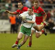 11 November 2007; John McGrath, Baltinglass, in action against Barry Mernagh, Rathnew. Wicklow Senior Football Championship Final Replay, Baltinglass v Rathnew, County Park, Aughrim, Co. Wicklow. Picture credit; Matt Browne / SPORTSFILE *** Local Caption ***