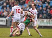 8 February 2015; Colm Boyle, Mayo, is tackled by Justin McMahon, right, and Tiernan McCann, Tyrone. Allianz Football League, Division 1, Round 2, Mayo v Tyrone, Elverys MacHale Park, Castlebar, Co. Mayo. Picture credit: David Maher / SPORTSFILE