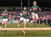 8 February 2015;  Mayo players from left, Aidan O'Shea, Keith Higgins and Kevin Keane, arrive at the team bench for the offical photograph. Allianz Football League, Division 1, Round 2, Mayo v Tyrone, Elverys MacHale Park, Castlebar, Co. Mayo. Picture credit: David Maher / SPORTSFILE