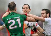 8 February 2015; Aidan O'Shea, Mayo, tussles with, Tyrone players Justin McMahon and Ronan McNamee shortly before been shown the black card from referee Eddie Kinsella. Allianz Football League, Division 1, Round 2, Mayo v Tyrone, Elverys MacHale Park, Castlebar, Co. Mayo. Picture credit: David Maher / SPORTSFILE