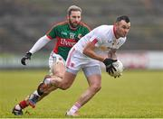 8 February 2015; Cathal McCarron, Tyrone, in action against Michael Conroy, Mayo. Allianz Football League, Division 1, Round 2, Mayo v Tyrone, Elverys MacHale Park, Castlebar, Co. Mayo. Picture credit: David Maher / SPORTSFILE