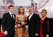 10 November 2007; Niamh Mulcahy, Cork, is presented with her Energise Camogie Munster Young Player of the Year Award by the Guest of Honour - Ireland and Leinster rugby player - Gordon D'Arcy, left, in the company of Cormac Farrell, Business & Marketing Manager, O'Neills Irish International Sports Co., and Liz Howard, right, Uachtarán Chumann Camógaíochta na nGael, at the Energise Sport Camogie All-Star Awards 2007 in association with O'Neills. Citywest Hotel, Conference, Leisure & Golf Resort, Saggart, Co. Dublin. Picture credit: Ray McManus / SPORTSFILE