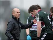 11 February 2015; St Mary's College, Belfast, manager Paddy Tally consoles Emmett Bradley after the final whistle. Independent.ie Sigerson Cup, Quarter-Final, St Mary's College, Belfast v DCU. St Genevieves High School, Belfast, Co. Antrim. Picture credit: Oliver McVeigh / SPORTSFILE