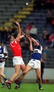 12 March 2000; Brian Corcoran, Cork, in action against James Young, Laois. Cork v Laois, National Hurling League, Páirc U' Chaoimh, Cork. Picture credit; Brendan Moran/SPORTSFILE