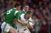 13 April 2000; David Murphy of Waterford is tackled by Stephen Lucey of Limerick during the Munster Under-21 Football Championship Final match between Waterford and Limerick at Fraher Field in Dungarvan, Waterford. Photo by Matt Browne/Sportsfile