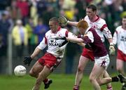 29 April 2000; Joe Campbell of Tyrone in action against Kieran Fitzgerald of Galway during the All-Ireland Under 21 Football Championship Semi-Final match between Galway and Tyrone at Páirc Seán Mac Diarmada in Carrick-On-Shannon, Leitrim. Photo by Damien Eagers/Sportsfile