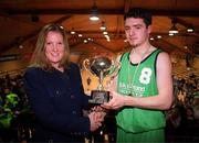 9 February 2000; Colaiste Mhuire Crosshaven captain Jonathan Fitzgibbon is presented with the cup by Catherine Roche of Bank of Ireland following the Bank of Ireland Schools Cup Boys' C Final match between Colaiste Mhuire Crosshaven and Carrick-On-Shannon CS at National Basketball Arena in Tallaght, Dublin. Photo by Brendan Moran/Sportsfile