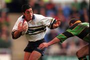8 April 2000; Kieran Campbell of London Irish in action against Alan Bateman of Northampton during the Tetley's Bitter Cup Semi-Final match between London Irish and Northampton at the Madejski Stadium in Reading, England. Photo by Brendan Moran/Sportsfile