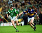 30 April 2000; Limerick's Mark Keane races clear of  Tipperary's David Kennedy. Tipperary v Limerick, National Hurling League Semi Final, Semple Stadium, Thurles. Picture credit; Ray McManus/SPORTSFILE
