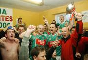 25 November 2007; Ballina Stephenites captain Colm Leonard holding cup celebrates at the end of the game in their dressing room with his team-mate Liam Brady and supporters. AIB Connacht Senior Club Football Championship Final, Ballina Stephenites, Mayo, v St. Brigid's, Roscommon. James Stephen's Park, Ballina, Co. Mayo. Picture credit; David Maher / SPORTSFILE