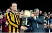 18 April 1982; Kilkenny captain Brian Cody is presented with the National Hurling League trophy by Uachtarán Chumann Lúthchleas Gael Paddy Buggy. 1981/82 National Hurling League Final, Kilkenny v Wexford. Croke Park, Dublin. Picture credit: SPORTSFILE