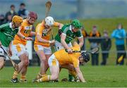 22 February 2015; Neil McAuley, Antrim, assisted by Aaron Graffin and Ryan McCambridge, is tackled by Shane Dowling, Limerick, as Tom Morrissey looks on. Allianz Hurling League, Division 1B, Round 2, Antrim v Limerick, Ballycastle, Co. Antrim. Picture credit: Oliver McVeigh / SPORTSFILE