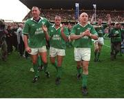 20 October 2001; Ireland players, from left, Trevor Brennan, Peter Clohessy and Keith Wood celebrate victory over England. Ireland v England, Six Nations Championship, Lansdowne Road, Dublin. Picture credit: Brendan Moran / SPORTSFILE