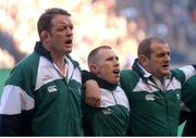 "16 February 2002; Ireland captain Mick Galwey, left,  sings ""Ireland's Call"" alongside Peter Stringer, centre, and Peter Clohessy  England. Lloyds TSB Six Nations Championship,  England v Ireland, Twickenham, England.  Picture credit: Matt Browne / SPORTSFILE"