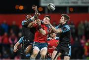28 February 2015; Ronan O'Mahony, Munster, goes up for the ball with Glasgow Warriors' Niko Matawalu and Richie Vernon. Guinness PRO12, Round 16, Munster v Glasgow Warriors. Irish Independent Park, Cork. Picture credit: Matt Browne / SPORTSFILE
