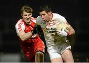 28 February 2015; Sean Cavanagh, Tyrone, in action against Niall Holly, Derry. Allianz Football League, Division 1, Round 3, Tyrone v Derry. Healy Park, Omagh, Co. Tyrone. Picture credit: Oliver McVeigh / SPORTSFILE