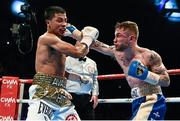 28 February 2015; Carl Frampton, right, exchanges punches with Chris Avalos during their IBF Super-Bantamweight World Title fight. The World is Not Enough, Odyssey Arena, Belfast, Co. Antrim. Picture credit: Ramsey Cardy / SPORTSFILE