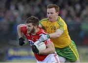 1 March 2015; Eoin Cadogan, Cork, in action against Eamonn Doherty, Donegal. Allianz Football League, Division 1, Round 3, Donegal v Cork. Fr Tierney Park, Ballyshannon, Co. Donegal. Picture credit: Oliver McVeigh / SPORTSFILE
