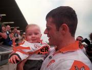 20 May 2000; Derry captain Anthony Tohill with his son Anton following his side's victory during the Church & General National Football League Final Replay match between Derry and Meath at St Tiernach's Park in Clones, Monaghan. Photo by David Maher/Sportsfile