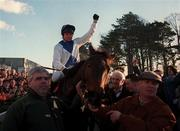 2 February 1997; Jockey Tommy Treacy celebrates as he is lead into the winners enclosure by trainer Thomas Foley, behind centre, after riding Danoli to victory in the Hennessy Cognac Gold Cup at Leopardstown Racecourse in Dublin. Photo by Brendan Moran/Sportsfile