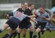 17 April 2004; Shane Stewart of Ballymena is tackled by Greg Mitchell, left, and Jarlath Carey of Belfast Harlequins during the AIB All-Ireland League Division 1 match between Belfast Harlequins and Ballymena at Deramore Park in Belfast. Photo by Pat Murphy/Sportsfile