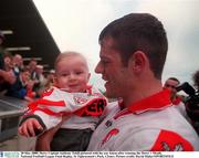 20 May 2000; Derry Captain Anthony Tohill pictured with his son Anton after winning the Derry v Meath, National Football League Final Replay, St Tighearnach's Park, Clones. Picture credit; David Maher/SPORTSFILE