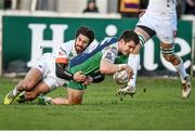 1 March 2015; Tiernan O'Halloran, Connacht, dives over to score his side's first try despite the tackle by Ludovico Nitoglia, Benetton Treviso. Guinness PRO12 Round 16, Connacht v Benetton Treviso, Sportsground, Galway. Picture credit: Ramsey Cardy / SPORTSFILE