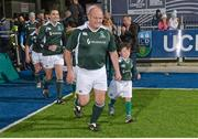 28 February 2015; Peter Clohessy, Ireland Legends, runs out for the start of the game with a team mascot. Ireland legends v England legends.  Donnybrook Stadium, Donnybrook, Dublin. Picture credit: Piaras Ó Mídheach / SPORTSFILE
