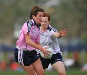 26 January 2008; Anne Marie Cox, Leitrim and 2007 Ladies All Stars, in action against Caoimhe Marley, Laois and 2006 Ladies All Stars. Exhibition Game, 2006 O'Neills/TG4 Ladies GAA All Stars v 2007 O'Neills/TG4 Ladies GAA All Stars, Dubai Polo and Equestrian Club, Dubai, United Arab Emirates. Picture credit: Brendan Moran / SPORTSFILE  *** Local Caption ***