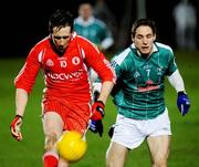 2 February 2008; Tyrone's Colm Cavanagh against Kildare's Gary White. Allianz National Football League, Division 1, Round 1, Tyrone v Kildare, Healy Park, Omagh, Co. Tyrone. Picture credit: Michael Cullen / SPORTSFILE