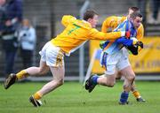 3 February 2008; John McGrath, Wicklow, in action against Justin Crozier, 7, and Paul Doherty, Antrim. Allianz National Football League, Division 4, Round 1, Wicklow v Antrim, County Park, Aughrim, Co. Wicklow. Picture credit: Pat Murphy / SPORTSFILE *** Local Caption ***
