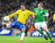 6 February 2008; Luis Fabiano, Brazil, in action against Richard Dunne, Republic of Ireland. International Friendly, Republic of Ireland v Brazil, Croke Park, Dublin. Picture credit; Pat Murphy / SPORTSFILE