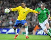 6 February 2008; Luis Fabiano, Brazil, in action against Richard Dunne, Republic of Ireland. International Friendly, Republic of Ireland v Brazil, Croke Park, Dublin. Picture credit; Pat Murphy / SPORTSFILE *** Local Caption ***