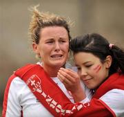 29 February 2008; Nicola Evans, Loreto Beaufort, is comforted by a fan after defeat in the final. Leinster Hockey Senior Cup Final, Alexandra College v Loreto Beaufort, Grange Road, Rathfarnham, Co.Dublin. Picture credit: Brian Lawless / SPORTSFILE