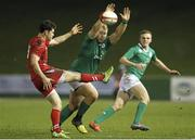 13 March 2015; Jeremy Loughman, Ireland, charges down a kick from Tom Williams, Wales. U20's Six Nations Rugby Championship, Wales v Ireland, Parc Eirias, Colwyn Bay, Wales. Picture credit: Magi Haroun / SPORTSFILE