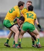 15 15 March 2015; Bryan Sheehan, Kerry, is tackled by Hugh McFadden, left, Eamonn Doherty and Ryan McHugh, Donegal. Allianz Football League, Division 1, Round 5, Kerry v Donegal, Austin Stack Park, Tralee, Co. Kerry. Picture credit: David Maher / SPORTSFILE