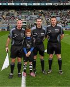 17 March 2015; Match referee James Owens, Wexford, with 'Young Whistler' Fionnbar Wanick, ten years, St Jude's GAA Club, and his linesmen James McGrath, left, and Brian Gavin, before the game. AIB GAA Hurling All-Ireland Senior Club Championship Final, Ballyhale Shamrocks, Co Kilkenny, v Kilmallock, Co Limerick. Croke Park, Dublin. Picture credit: Ray McManus / SPORTSFILE