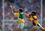 18 June 2000; Michael Duignan of Offaly in action against Sean Flood of Wexford during the Guinness Leinster Senior Hurling Championship Semi-Final match between Offaly and Wexford at Croke Park in Dublin. Photo by Ray McManus/Sportsfile