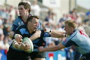1 May 2004; Andrew Thompson of Shannon in action against  Colin Atkinson, left, and Greg Mitchell of Belfast Harlequins during the AIB All-Ireland League Division 1 Semi-Final match between Shannon and Belfast Harlequins at Thomond Park in Limerick. Photo by Sportsfile