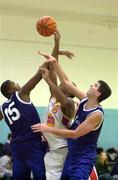 4 December 1999; Kareem Lewis of BK Limerick in action against Ferdinand Williams, 15, and Brian Tonkovich of St Vincent's during the ESB Men's Superleague Basketball match between St Vincent's and BK Limerick at St Vincent's Basketball Club in Glasnevin, Dublin. Photo by Brendan Moran/Sportsfile