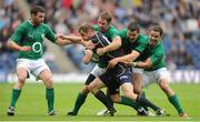 6 August 2011; Chris Paterson, Scotland, is tackled by Ireland's Tomas O'Leary, Jonathan Sexton and Paddy Wallace with Fergus McFadden, left. Rugby World Cup Warm-up Game, Scotland v Ireland, Murrayfield Stadium, Edinburgh, Scotland. Picture credit: Brendan Moran / SPORTSFILE