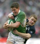 11 March 2006; Ronan O'Gara, Ireland, is tackled by Scott Lawson, Scotland. RBS 6 Nations 2005-2006, Ireland v Scotland, Lansdowne Road, Dublin. Picture credit: Brendan Moran / SPORTSFILE