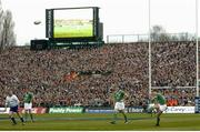 27 March 2004; Ronan O'Gara, Ireland, kicks a penalty against Scotland watched by fans in the South Terrace. RBS Six Nations Rugby Championship 2003-2004, Ireland v Scotland, Lansdowne Road, Dublin. Picture credit; Brendan Moran / SPORTSFILE