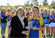 21 March 2015; St Patrick's College Drumcondra captain Niamh Kelly, from Moy Davitts, Co. Mayo, is presented with the Player of the Match award by LGFA president Marie Hickey. Donaghy Cup Ladies Football Final, St Patrick's College Drumcondra v Liverpool Hope University. Cork IT, Bishopstown, Cork. Picture credit: Diarmuid Greene / SPORTSFILE