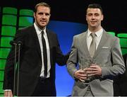 22 March 2015; Danny Long, Avondale United, winner of the Intermediate player of the year award, is presented with his award by Republic of Ireland International John O'Shea at the 3 FAI International Football Awards. RTE Studios, Donnybrook, Dublin. Picture credit: David Maher / SPORTSFILE