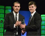22 March 2015; Republic of Ireland International Danny Kane, winner of the Republic of Ireland U17 player of the year award, is presented with his award by Republic of Ireland International John O'Shea at the 3 FAI International Football Awards. RTE Studios, Donnybrook, Dublin. Picture credit: David Maher / SPORTSFILE