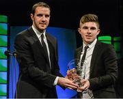22 March 2015; Ryan Manning, Yeats College, Galway, winner of the FAI Schools International player of the year award, is presented with his award by Republic of Ireland International John O'Shea at the 3 FAI International Football Awards. RTE Studios, Donnybrook, Dublin. Picture credit: David Maher / SPORTSFILE