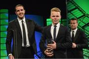 22 March 2015; Republic of Ireland International Anthony Scully, winner of the Republic of Ireland U15 player of the year award, is presented with his award by Republic  of Ireland International John O'Shea at the 3 FAI International Football Awards. RTE Studios, Donnybrook, Dublin. Picture credit: David Maher / SPORTSFILE
