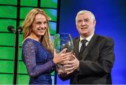 22 March 2015; Republic of Ireland International Julie Ann Russell, winner of the Republic of Ireland Women's player of the year award, is presented with her award by FAI President Tony Fitzgerald at the 3 FAI International Football Awards. RTE Studios, Donnybrook, Dublin. Picture credit: David Maher / SPORTSFILE